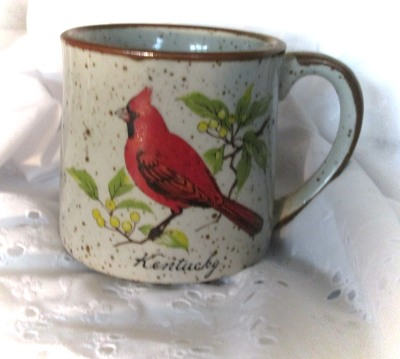 image of cardinal on a coffee cup